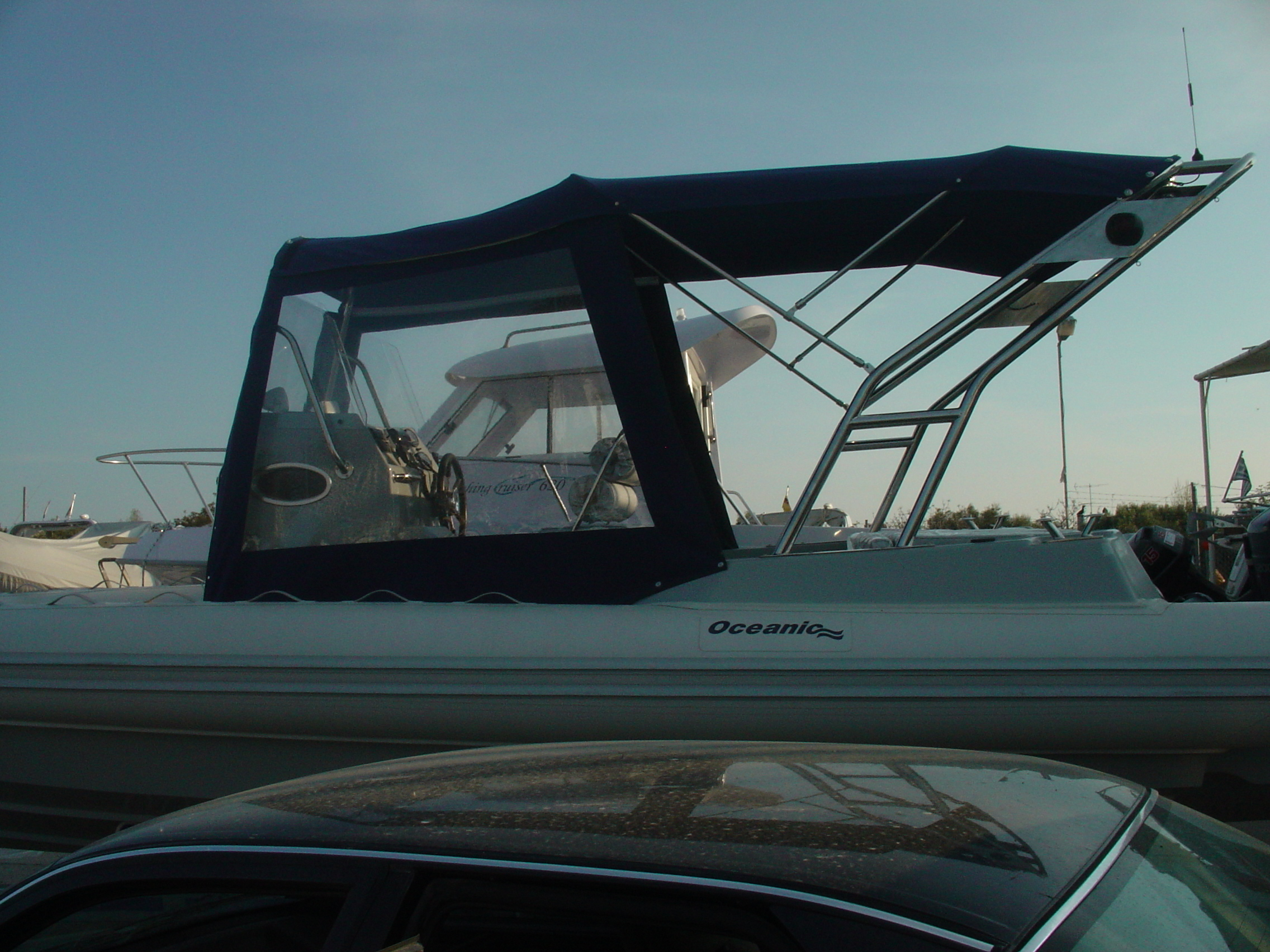 Bimini Top & Camber Top with side and afr Curtains